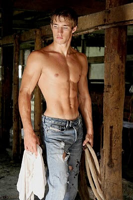 hot shirtless guy in a barn
