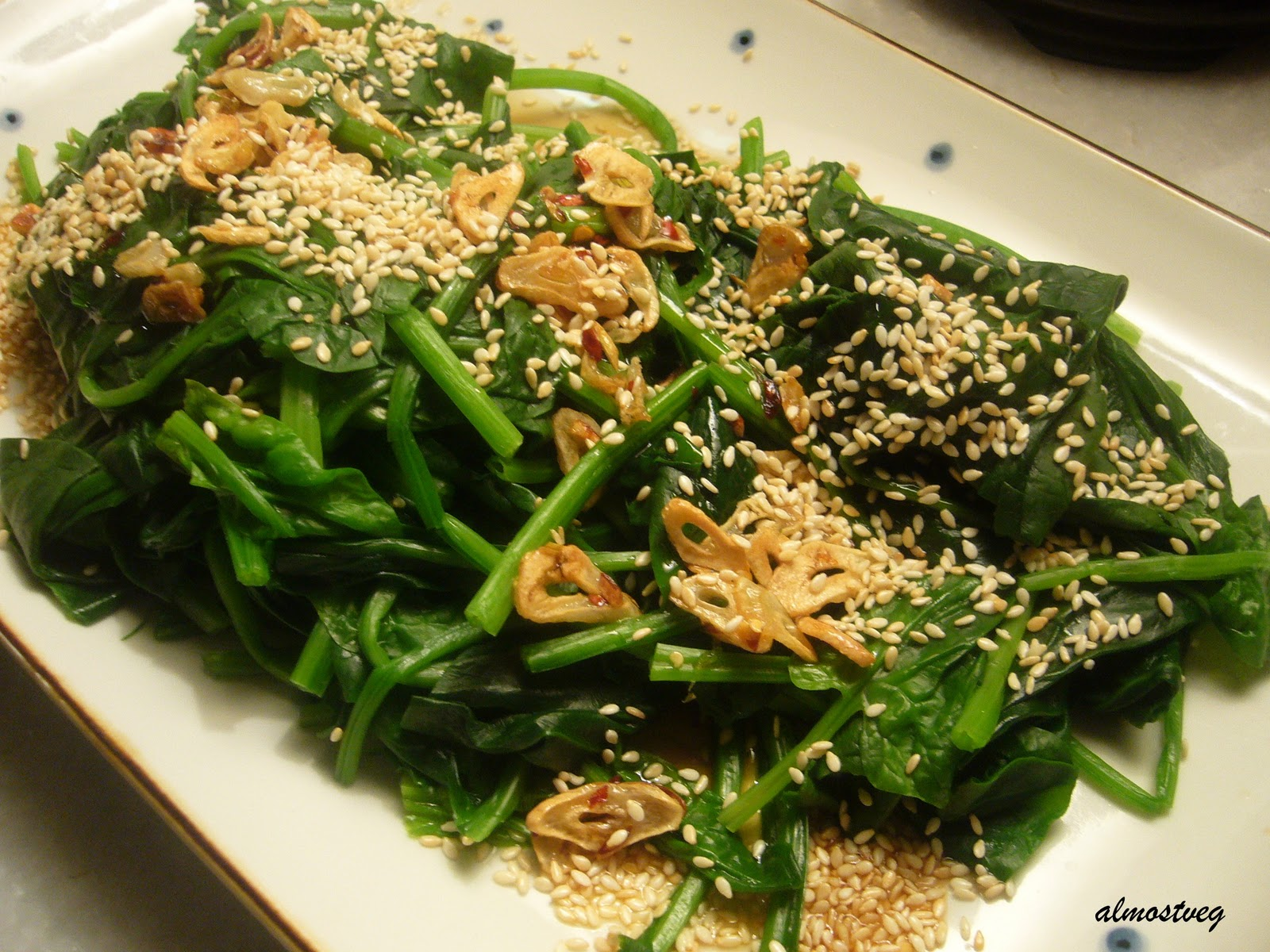 Steamed spinach with garlic chips