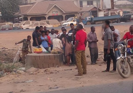 Unbelievable! People Gather Around Mad Woman in Aba to Get Lucky Betting Numbers (Photos)