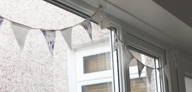 purple and cream bunting in kitchen window