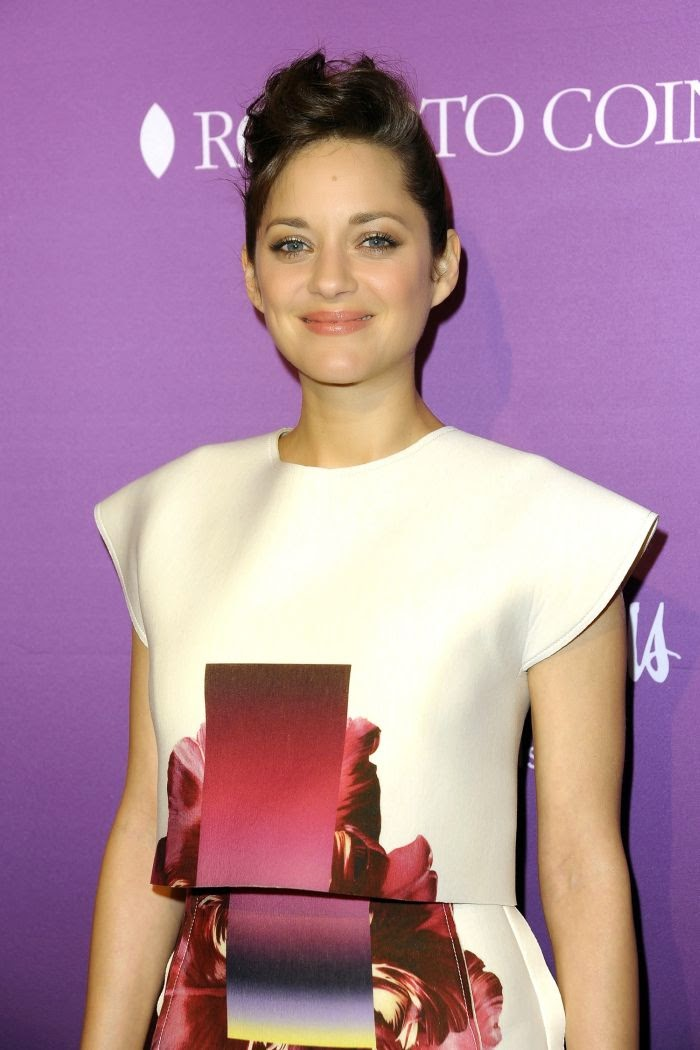 Marion Cotillard wears a teal white dress by Caroline Herrera for tonight's The Hollywood Reporter's Annual Oscar Nominees party at Los Angeles on Monday, February 2, 2015.
