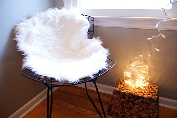 bertoia chair with faux lamb skin and christmas lights