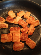 Other side of sweet potato gnocchi being cooked in saute pan.