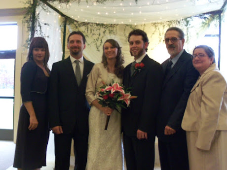The parents with the bride and groom