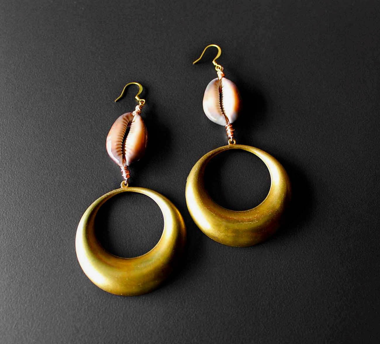 african brass earrings with cowry shells