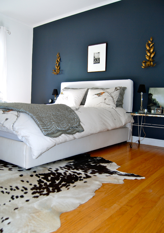 the home of bambou bedroom with dark accent wall