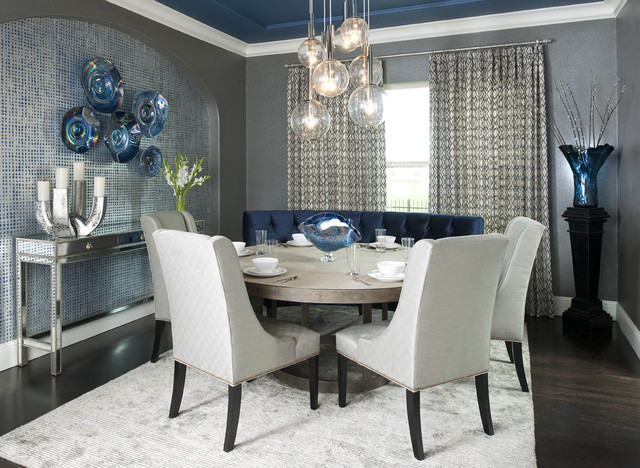 Modern Dining Room Style with Round Dining Tables and Blue Curve Bench under the Bubble Lamps