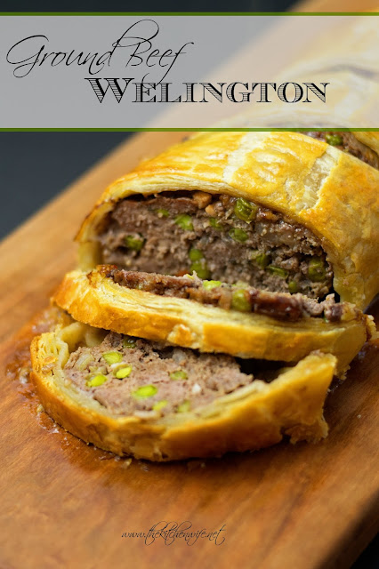 The finished ground beef wellington, on a cutting board, with the title above it.