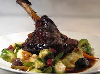 Picture of a Braised Lamb and Vegetables on a white plate