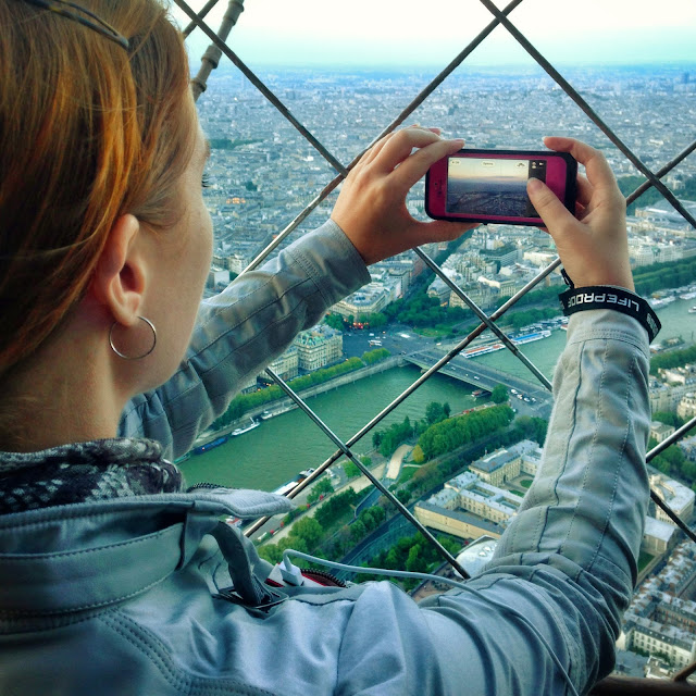 Capturing the moment on the top of the Eiffel Tower in Paris France with my LifeProof iPhone 5 in Magenta