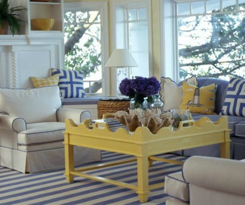 Coastal living room with beautiful cottage accents, slipcover sofa ans chairs