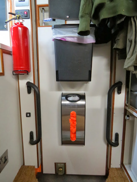 Brabantia bin and Simple Human bag holder fitted to motorhome entrance door
