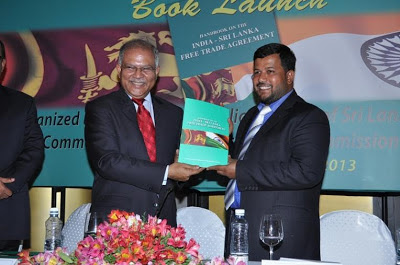 "Ashok K. Kantha hands over a copyof ""Handbook on the India-Sri Lanka"