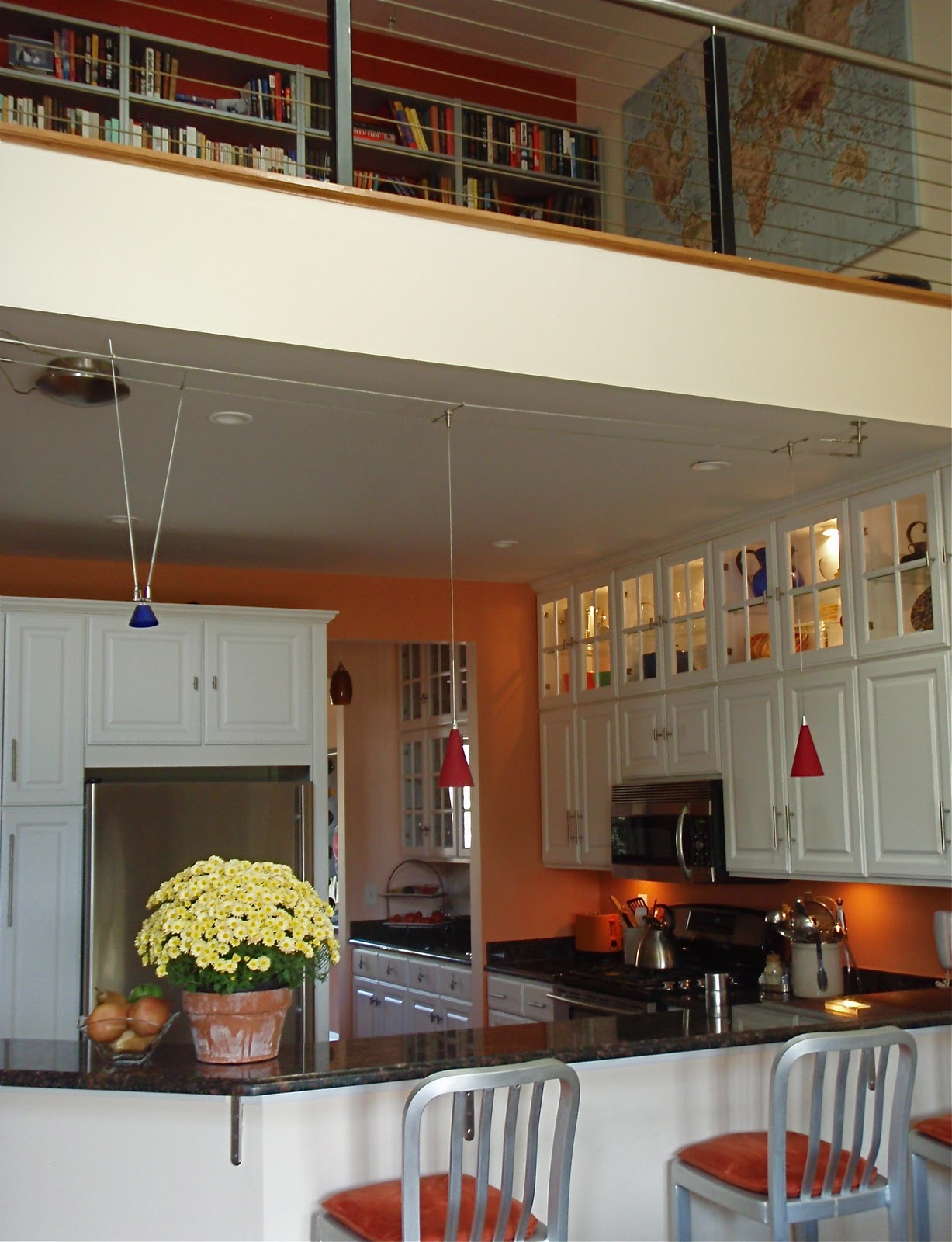 Directly above the kitchen is the loft. We love the cable railing