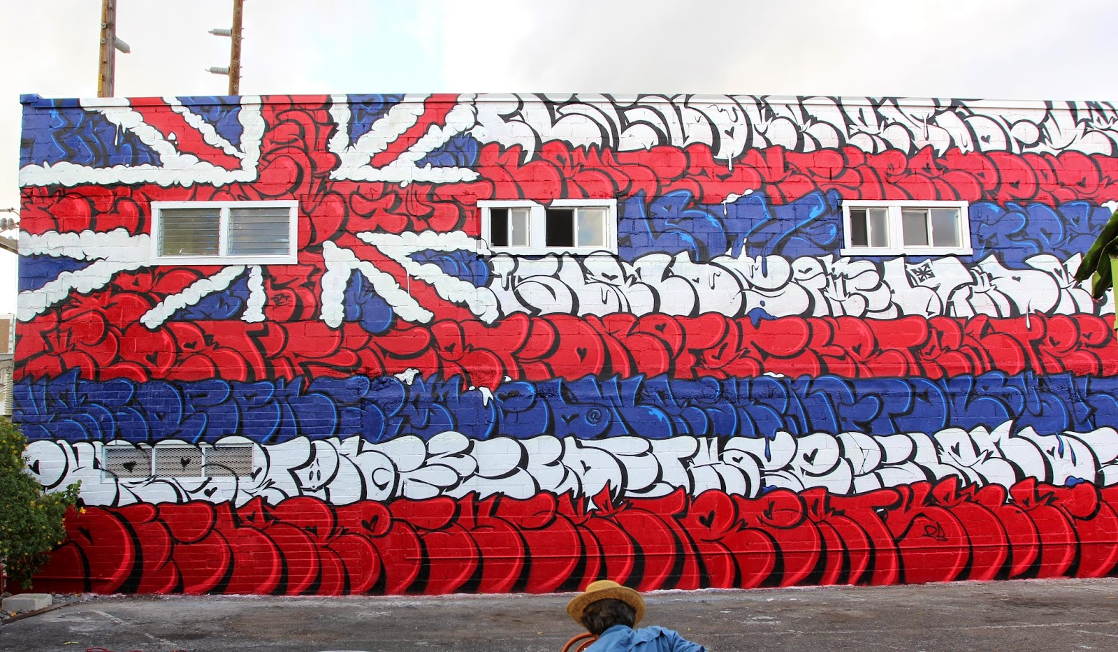"OG Slick is also part of POW! WOW! '15's stellar line-up where he was invited to work on a massive building. Using the Hawaiian flag as a canvas for his letter, it took almost a week for the OG Slick to wrap up this piece entitled ""Can't Save The Queen""."