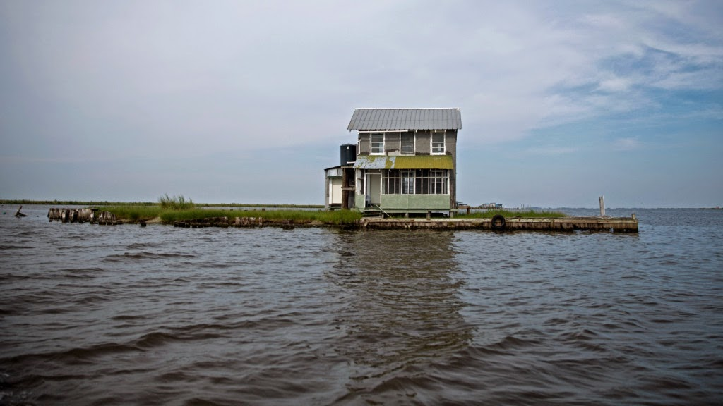 House surrounded by water (Credit: Edmund D. Fountain, ProPublica/The Lens) Click to enlarge.