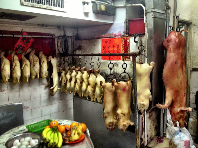 Pigs hanging waiting to be cooked in a steel oven - Hong Kong