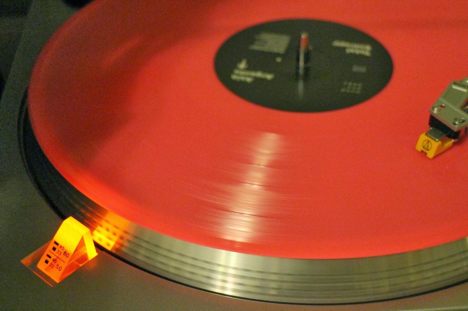Asia Argento Total Entropy vinyl LP, pink vinyl, glowing vinyl record spinning