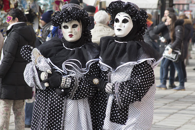 costumed couple on San Marco square in Venice