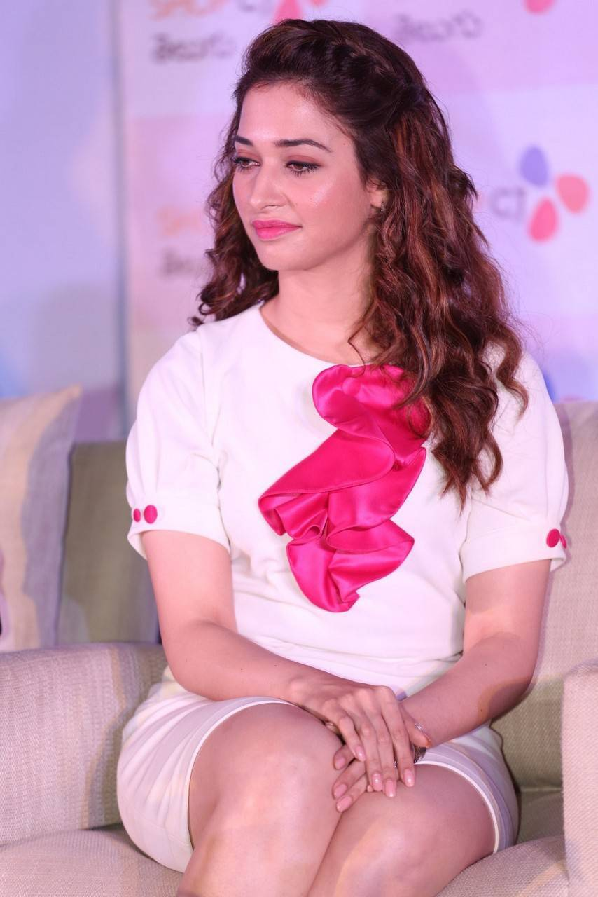 tamanna bhatia pictures: tamanna latest stills at shop cj store