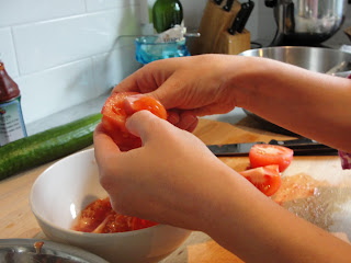 peeling tomatoes into bowl
