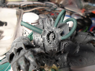 A close up of the converted HelBrute's face showing the cables coming off the crown