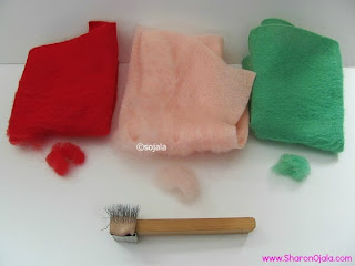 three felt sheets red pink and green