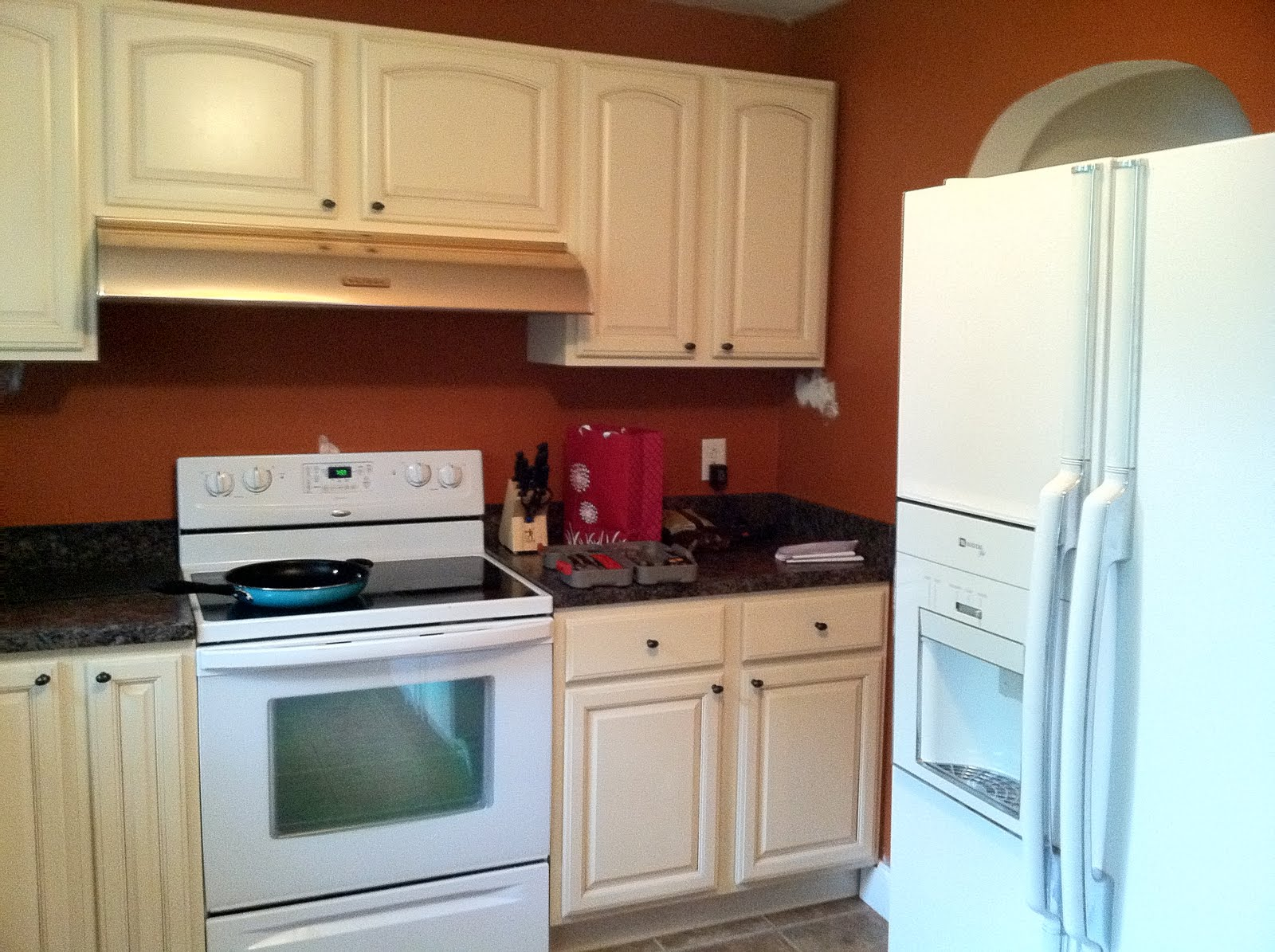 Burnt Orange Kitchen With White Cabinets