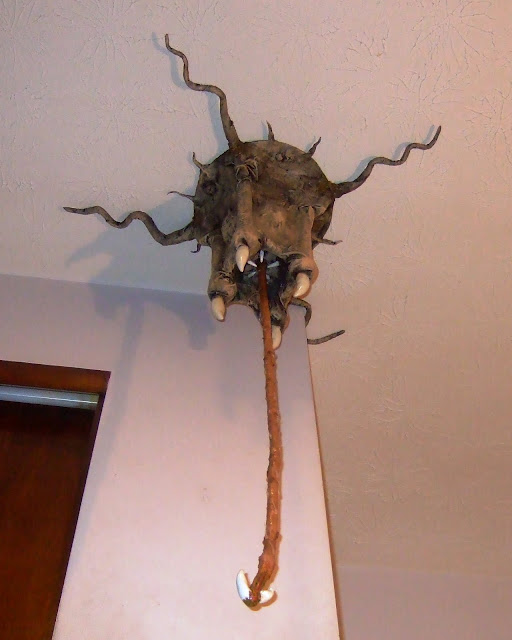 barnacle monster sculpture with tentacle