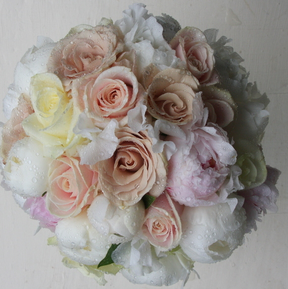 A Bridal Bouquet Created From A Collection Of Vintage Toned Roses, Sweet  Peas And Peonies
