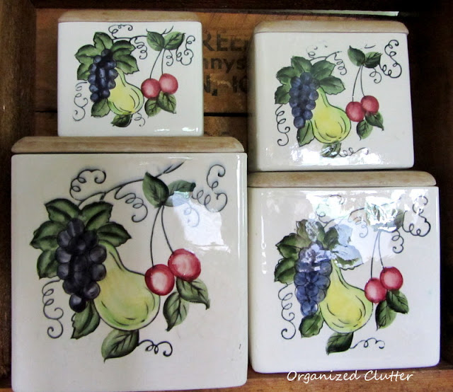 Vintage Ceramic four piece canister set fruit motif and wood lids