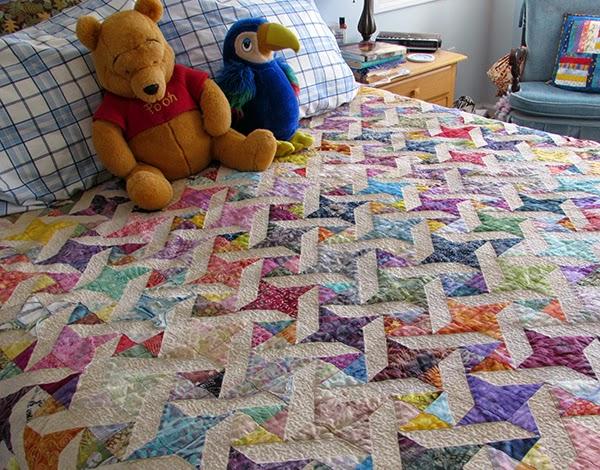 scrappy bed quilt