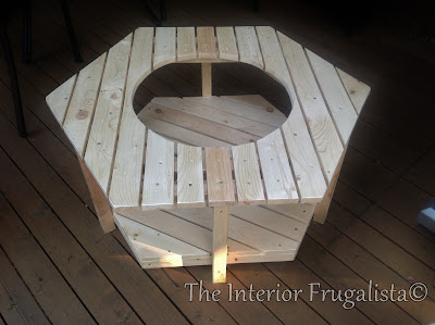 DIY fire bowl table cut out in the center to accommodate the fire bowl.