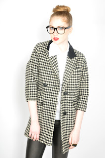 Vintage 1980's black and white houndstooth print jacket with black velvet collar.