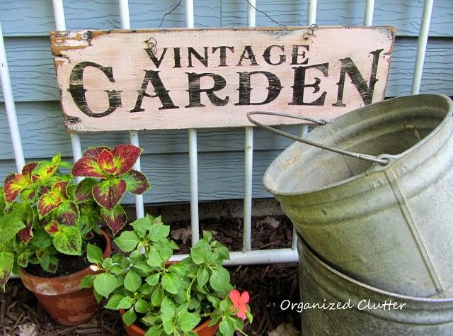 Vintage Garden Sign & Vignette www.organizedclutterqueen.blogspot.com