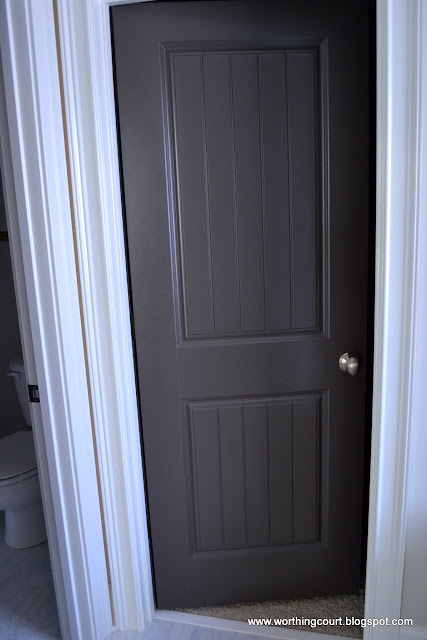 interior door painted charcoal gray via Worthing Court blog