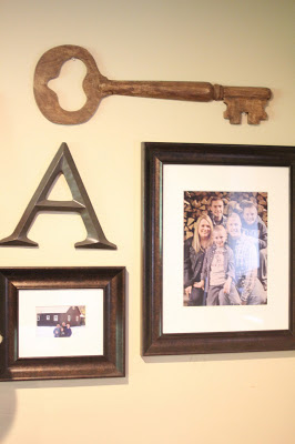 gallery wall with antlers and keys via www.goldenboysandme.com