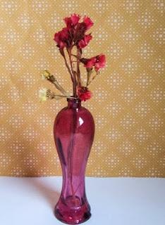 http://manualidades.facilisimo.com/blogs/general/reutilizar-los-frascos-de-colonia-vacios_1071668.html