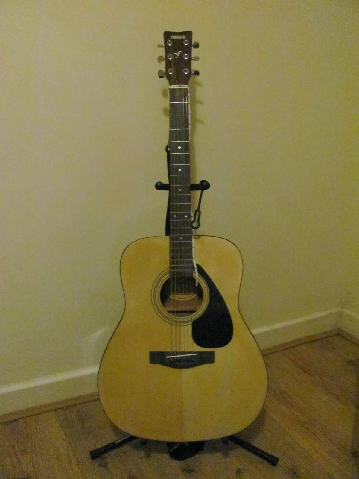 Yamaha F310 Acoustic Guitar on stand