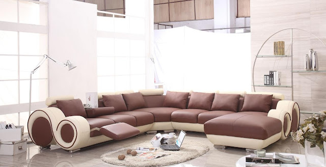 extraordinary brown and white modern reclining sofa in unique shape with oval soft brown fur rug and commercial standing lamp