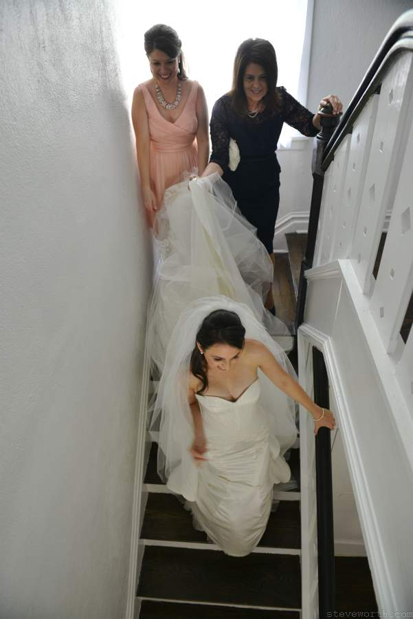 Bride going down the stairs to wedding