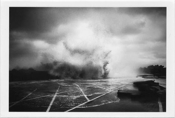 dirty photos - et - a black and white photo of big waves in rethymno port