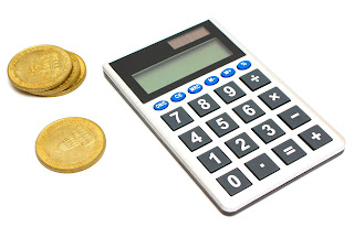Calculator & gold coins; source:http://www.freestockphotos.biz; by Benjamin Miller