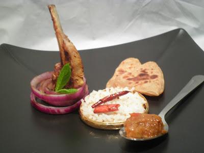 fine dining indian picture of lamb masala pathar ka gosht kerala paratha recipe