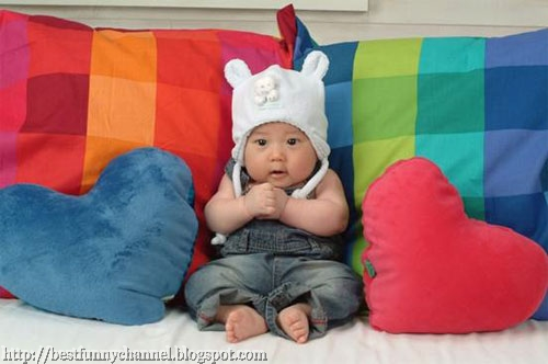 Cute baby  on the couch.