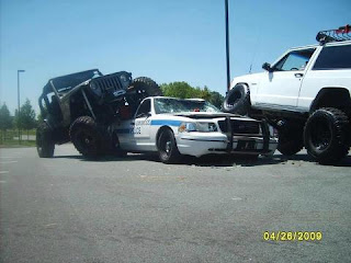 Funny pictures of cops: police car run over by two jeeps