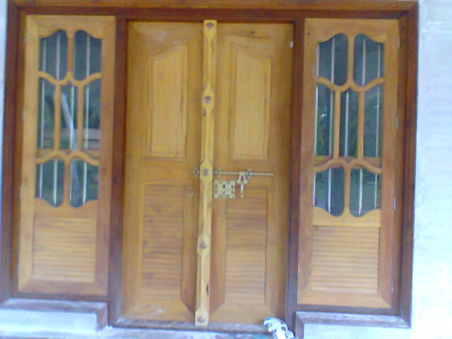 Wooden doors wooden doors kerala style for Window glass design in kerala