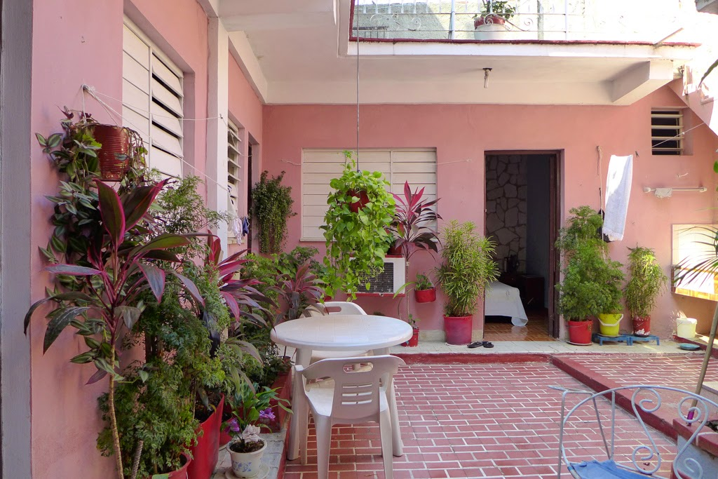 Santiago de Cuba interior courtyard in pink with plants