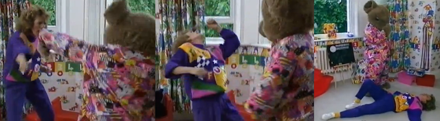 Joggy Bear punches Lizzie Webb in the face
