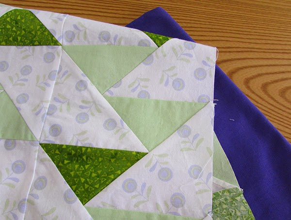 green and purple fabrics for table runner kits